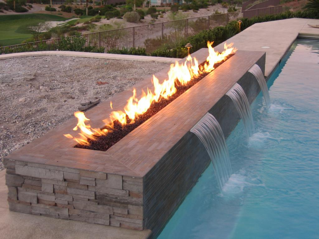 poolside fireplace and waterfall